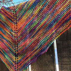 """Marilyn's Easy Rainbow shawl is, as the name implies, an easy knit. It is perfect for beginning knitters, or easy TV knitting for more advanced knitters. I originally learned to knit English style, and used this pattern to practice Continental style knitting. The pattern was designed for my friend Marilyn, who said, """"No one can teach me to knit something"""". I took up the challenge and the Rainbow shawl was begun."""
