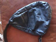 A personal favorite from my Etsy shop https://www.etsy.com/listing/481930464/black-leather-side-sling-shoulder-bag