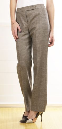 ESCADA PANTS...whatever that is. I don't think I like the piece of fabric that goes across the button