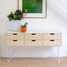 Leonard sideboard is minimal in design and beautifully hand made. It is a compact size to fit in most modern homes. Made of blond Birch plywood and varnished matt, the top is covered with a pale grey graphic Formica. The sideboard has sculptural steel legs, powder coated in pale grey. Leonard got his name from James Leonard the forward thinking post war designer of practical yet beautiful British school furniture. Measurements: 145 cm long, 38 cm deep and 81 cm high.All