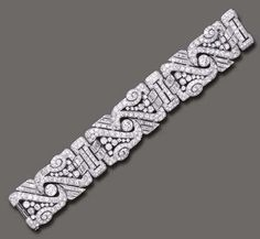 An Art Deco Diamond Bracelet The Wide Flexible Band Composed Of Three Openwork Old European