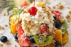Recipe by My favorite meal to eat is a fresh fruit platter, so having a Catamaran aka pineapple boat fits right into my idea of the perfect lunch. Food Network Recipes, Whole Food Recipes, Vegan Recipes, Easy Salads, Summer Salads, Pineapple Boats, Good Food, Yummy Food, Fun Food