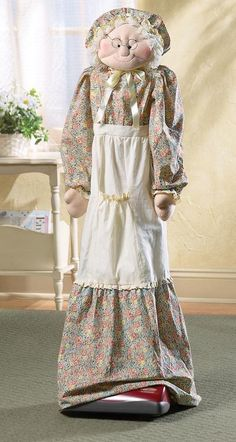 No place for your vacuum cleaner? Dress it up with this whimsical cover. It s styled to look like a grandma, with a long skirt to slip over the vacuum handle. Fits most upright vacuums. Cotton/polyest