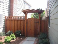 Garden fence gate with T Trellis over it. I like this as an idea for our fence. HMMMM.