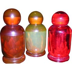 Set of 3 Vintage Bakelite Perfume Bottles from looluus on Ruby Lane
