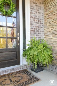 Spring Decorated Rocking Chair Front Porch with ferns in urns on either side of glass door