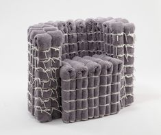 Wall-To-Wall, by Emre Bagdatoglu // a chair that consists of folded carpet strips packed together by utility rope, creating a unique look.