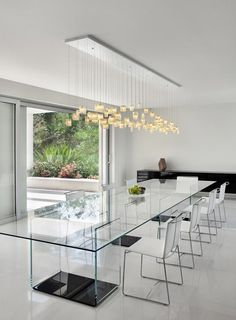 A clear glass dining table