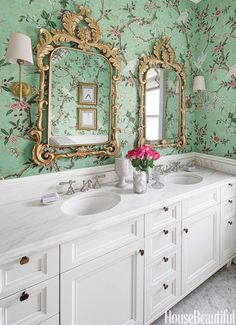 A chinoiserie-wallpapered bathroom for two young girls.
