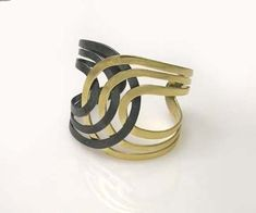 Bangle/Cuff | K. Mita. 18K Yellow, Silver......Connie Fox: Your eye does a lot of traveling on this cuff.