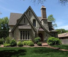English Cottage style home. Love the roof lines. by marcy
