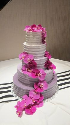 Your Reception at The Fez includes your cake by Wedding Cakes by Brenda McGee - Five Tier Round with Cascading Orchids and Purple Icing