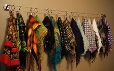 DIY Scarf Organizer : curtain wire w/wall mounts + moveable clips (from Ikea)... very simple!