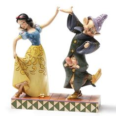 """When Sneezy and Dopey ask Snow White to dance, the three of them make a charming couple. """"DANCING PARTNERS"""" - SNOW WHITE WITH SNEEZY & DOPEY FIGURE (JIM SHORE DISNEY TRADITIONS)"""