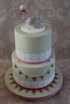 www.facebook.com/cakecoachonline - sharing...Lace, bunting and fondant elephant: lots of pretty elements on this cake.