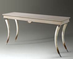 This Texas girl is completely swooning over The Kyloe by Theodore Alexander. This piece was named after the Scottish word for Highland Cattle (and their distinctive horns). A Transitional cream anagre console table with rectangular top and half moon apron detail placed upon tapering inswept faux bull horn legs with stainless steel capitals and feet. The perfect marriage of traditional & contemporary!  64 x 18 x 32 #hpmkt #stylespotters 411 Tomlinson