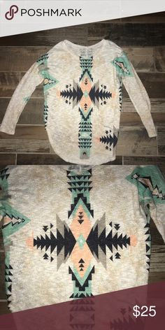 Lightweight tribal sweater size S Perfect paired with leggings for fall, this tribal print sweater is comfortable and on trend. I live in Florida, so I want someone who can enjoy it and actually wear it. Size S Sweaters