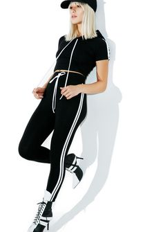 Smoked Cash Out Sporty Set is about ta set you up for f*xkin' life, bb! This dope set features a pair of ultra cute high waisted leggings in a stretchy black color with varsity stripes down tha sides and an awesome cropped short sleeve hoodie with stripes on the sleeves for a match made in heaven~