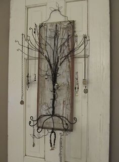 Sassytrash: Primitive jewelry tree... Take one chippy old door panel......add a twisty wire tree......and...'ta-ra!'..  you'l get a funky and functional jewelry holder for hanging on the wall...