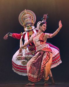 Kathakali is a stylized classical Indian dance-drama noted for the attractive make-up of characters, elaborate costumes, detailed gestures and well-defined body movements presented in tune with the anchor playback music and complementary percussion. The woman dancer exemplifies Kathak style.