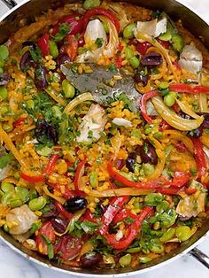 Vegetarian paella: 3 tbsp olive oil ½ Spanish onion, finely chopped ½ red, green and yellow pepper, deseeded and cut into strips ½ fennel bulb, cut into strips 2 garlic cloves, peeled and crushed 2 bay leaves ½ tsp smoked paprika ½ tsp turmeric ½ tsp cayenne 150g Calasparra rice 100ml sherry 1 tsp saffron strands 500ml boiling vegetable stock Sea salt 12 mini plum tomatoes 5 small grilled jarred artichokes, quartered 300g podded broad beans, blanched and skinned 10 pitted Kalama