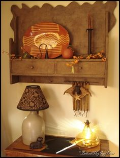Shelf. . .Redware. . .Candle Snuffer. . . Love this! This shelf hangs on the wall of blogger Behind My Red Door. . .