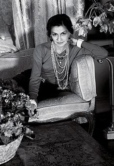 Coco Chanel; I cannot get enough of the layers and layers of pearls.  I need to wear this more often, it's like playing dress-up as a grown-up