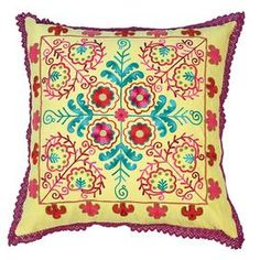 """Karma Living embroidered throw pillow with a multicolor tribal floral motif.     Product: PillowConstruction Material: UltrasuedeColor: YellowFeatures:  Insert includedEmbroidered fabric Charming design  Dimensions: 20"""" x 20"""""""