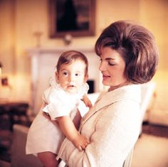 Jacqueline Kennedy holding her son John F. Kennedy Jr, JFK in office when I was born hence my parents named me Jacqueline.