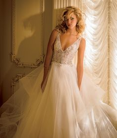 Eve of Milady Boutique Collection Style 1558. YA'LL we have this in store right now and it is STUNNING.