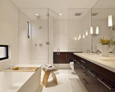One of the biggest deterrents to a breezy bath is a visually impairing shower curtain or short tiled wall.