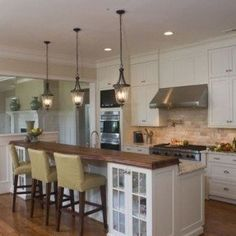 White cabinets, granite, wood for bar. Kitchen Islands With Raised Bar