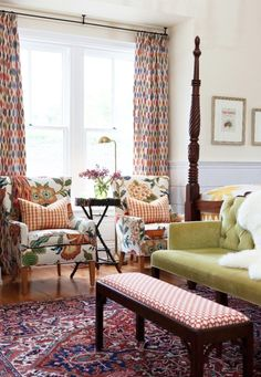 Schumacher Armchair in Hot House Flowers Spark, Drapes in Sunara Ikat Spice, Bench in Betwixt Spark, Pillows Elton Cotton Check Pumpkin, Loveseat in Gainsborough Velvet Palm
