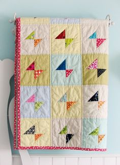 great scrap-buster quilt idea and look at how lovely it looks with various muted solids for the background.  LOVE