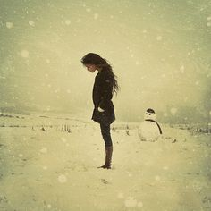 in the snow, her head looks too big, and not a fan of the snowman, but very serene, i like it