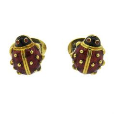 A pair of 18k yellow gold cufflinks coated with red enamel depicting ladybugs with garnet eyes.  DESIGNER: Hidalgo  MATERIAL: 18K…