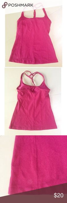 "Athleta strappy bra tank top sleeveless pink xs This is a strappy back tank top by Athleta. It has a built in bra and is a beautiful vibrant pink with lighter heather. Size xs. Nylon blend. Machine wash, tumble dry.  Arm pit to arm pit: 14""-18"" Waist: 13""-18"" Arm pit to hem: 15.5"" Athleta Tops Tank Tops"