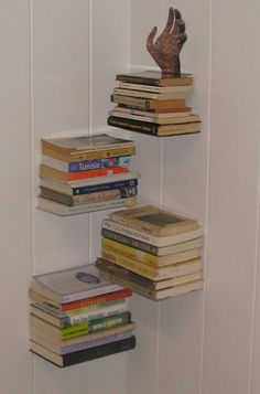 "Floating book shelves, ""zipper"" layout in corner. Instructables.com guide. Instead of using one bracket, would make it sturdier by using 2."