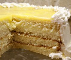 """Here's the perfect dessert for Easter: Lemon Truffle Cake. It's a four-layer white cake with a creamy lemon filling. The """"lemon truffle"""" consists of lemon curd with white chocolate and cream cheese mixed in. It's pretty much to-die-for. Lemon Desserts, Lemon Recipes, Just Desserts, Sweet Recipes, Delicious Desserts, Cake Recipes, Dessert Recipes, Lemon Truffles, Oreo Truffles"""