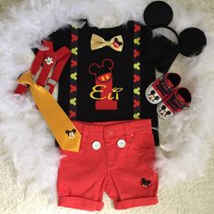 Personalised Mickey mouse theme 1st Birthday suspenders outfit-includes personalised onesie or tee, bottom,and Mickey shoes. Other pieces not included in this set price.To complete your outfit Please add to other matching items , add on listings are shown as below⬇️  Too add Booties/shoes https://www.etsy.com/au/listing/216709075/shoes-made-to-match-your-harushoneybee?ref=shop_home_active_9  Please measure your baby feet before ordering. Sizes are as follows: size 11 are inter length 10.5 cm…