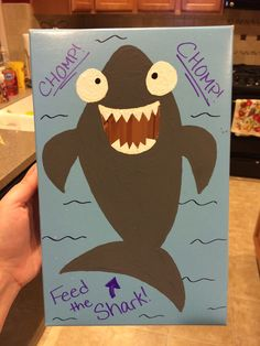 By taking a shoebox, painting it, and cutting out a hole for the mouth, you can make a cheap and easy Feed the Shark game!