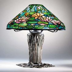 A 'POND LILY' LEADED GLASS AND BRONZE TABLE LAMP Tiffany Studios, circa 1910 on a 'cat-tail' base .
