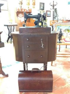 Well Preserved Antique Singer Sewing Machine and Antique Sewing Cabinet