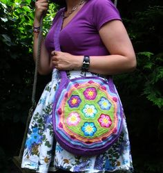 This sweet lil'hippi-granni style crochet bag is something I would have used as a purse back in 1969. But today I would probley use it as a beach bag or xtra catch all. It is beautifuly made & very colorfull...I like it. And looks good on the model especialy with those colors of purple :)  (Crafty Valley)