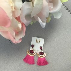 Red & Pink Tassel Statement Earrings These are sure to start a conversation! Beautiful red and pink tassel earrings with bold rhinestone details by T&J designs. 3 inches long, gold plated based metal, NWT retail and comes in a sealed plastic packaging. T&J Designs Jewelry Earrings