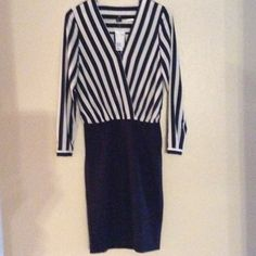Office / work H&M navy striped blouse dress This is a an H&M dark navy dress. The top part is a little sheer. It is 100% polyester. It is navy with off white/cream stripes. It is a little flowy. The bottom part is like a pencil skirt. It is a little stretchy. It is 65% viscose, 30% polyamide, and 5% elastane. There is a zipper on the left side of the dress, as seen in the last picture. The sleeves each have a navy button. H&M Dresses