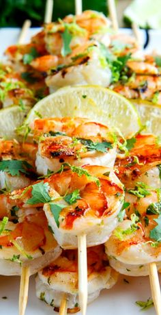 Shrimp Tacos Discover Cilantro Lime Grilled Shrimp Cilantro Lime Grilled Shrimp Shrimp in a tasty light and fresh cilantro lime marinade that is grilled to perfection. Pork Rib Recipes, Grilling Recipes, Fish Recipes, Seafood Recipes, Mexican Food Recipes, Chicken Recipes, Cooking Recipes, Healthy Recipes, Yummy Recipes