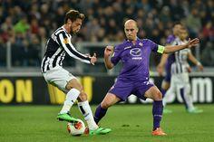 Claudio Marchisio (L) of Juventus turns Borja Valero of ACF Fiorentina during the UEFA Europa League Round of 16 match between Juventus and ...