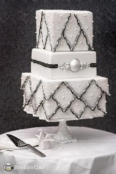 Sparkling Winter Wedding Cake by Brooklyn Cake. This wedding cake was inspired by winter, covered in sparking sugar and shiny decoratifs. This cake tries to capture an antique feel with a quilted tier and antique-style ornaments. Black And White Wedding Cake, White Wedding Cakes, Beautiful Wedding Cakes, Gorgeous Cakes, Pretty Cakes, Amazing Cakes, Black White, White Cakes, White Weddings