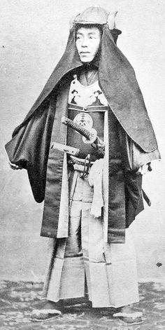 Samurai wearing a fire costume (kaji shozoku) consisting of a kaji kabuto (fire helmet) with a kaji shikoro (fire cape) attached to the bottem edge of the helmet, he is also wearing a kaji haori and muneate (fire jacket and breast protector).
